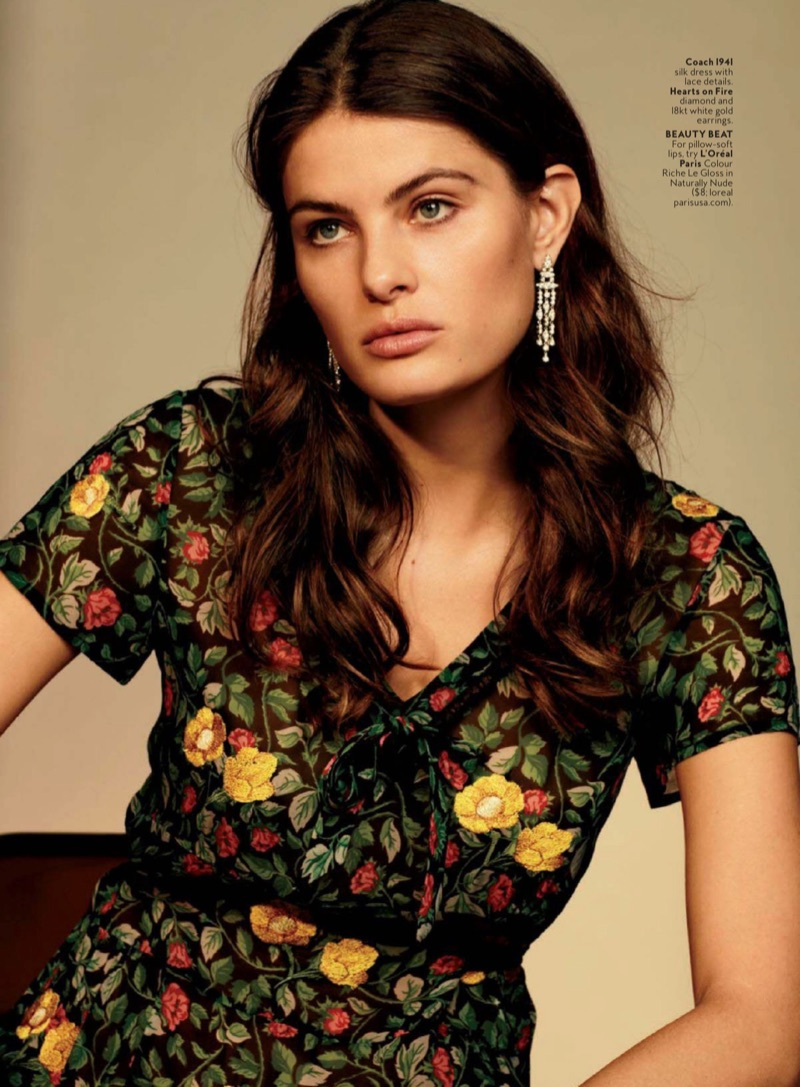 Striking a pose, Isabeli Fontana models Coach 1941 silk dress with lace details and Hearts on Fire earrings