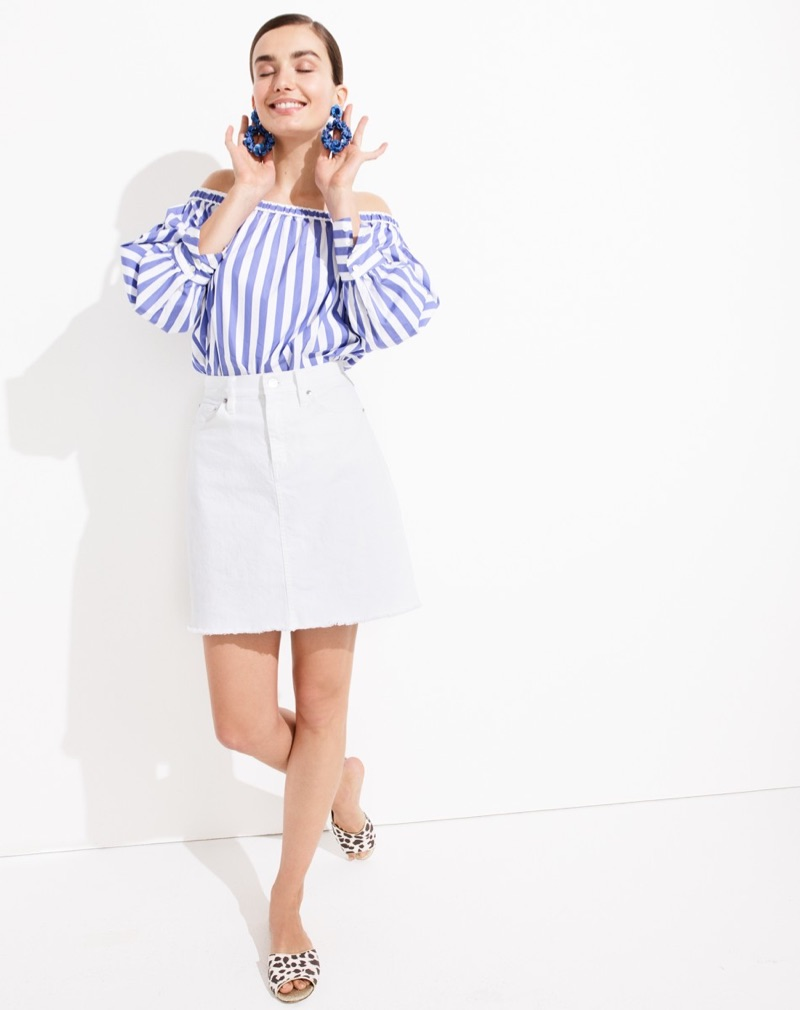 Thomas Mason for J. Crew Off-the-Shoulder Striped Top. J. Crew White Denim Skirt with Raw Hem, Leather-Backed Sequin Petal Earrings and Leopard Slide Sandals