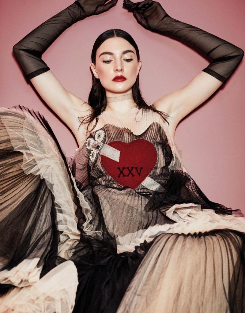 Model Jacquelyn Jablonski poses in Gucci dress and gloves
