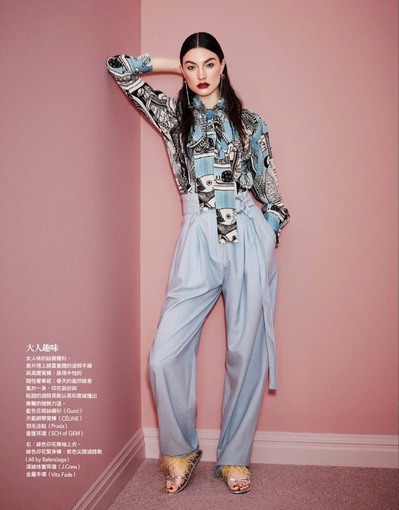 Striking a pose, Jacquelyn Jablonski models Gucci shirt, Celine pants and Prada sandals