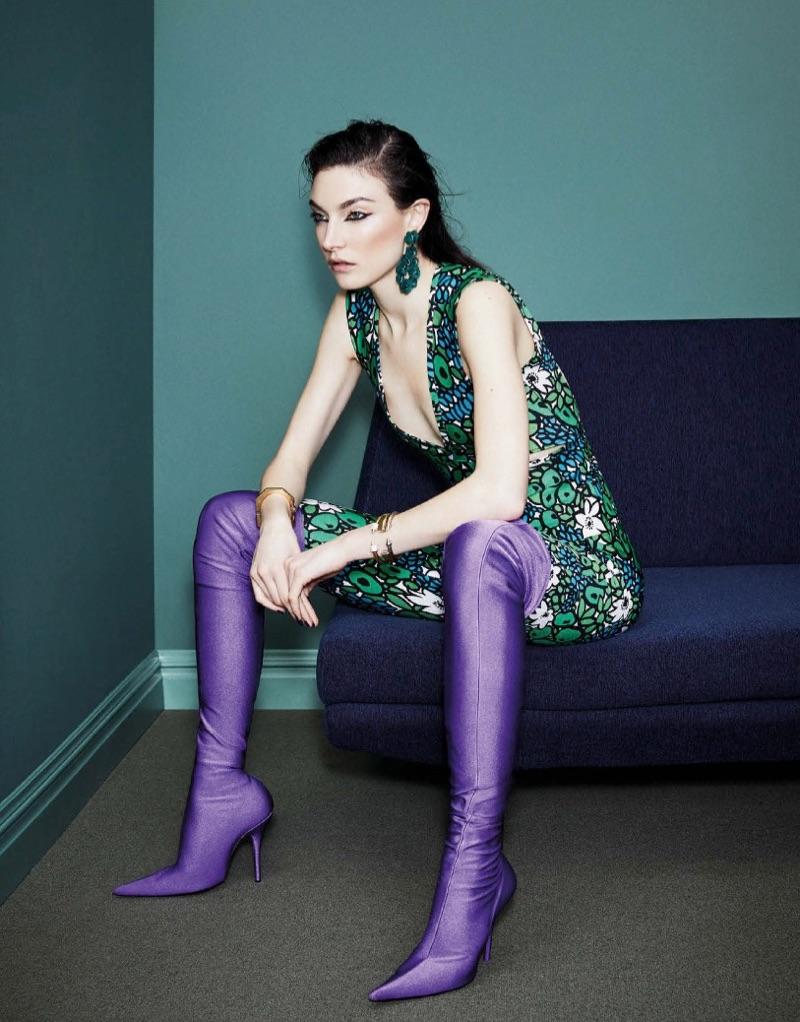 Jacquelyn Jablonski poses in Balenciaga dress and boots