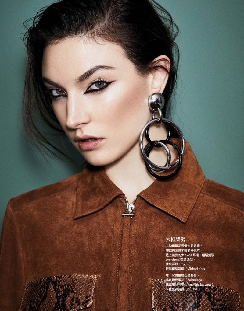 Getting her closeup, Jacquelyn Jablonski models Tod's jacket and Michael Kors Collection earrings