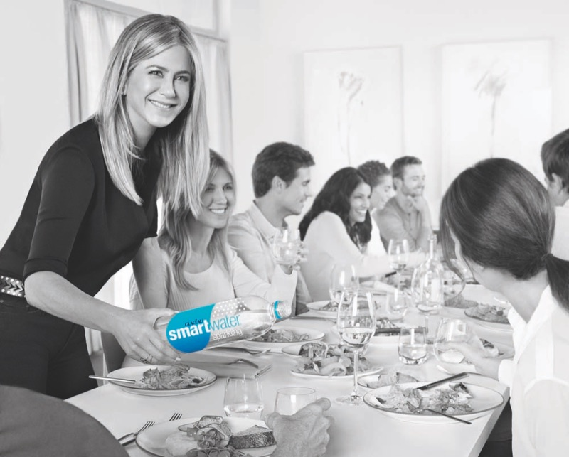 At a dinner party, Jennifer enjoys Smartwater sparkling