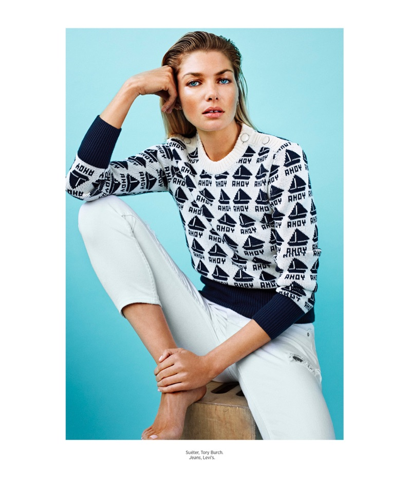 Keeping it casual, Jessica Hart poses in Tory Burch sweater and Levi's jeans
