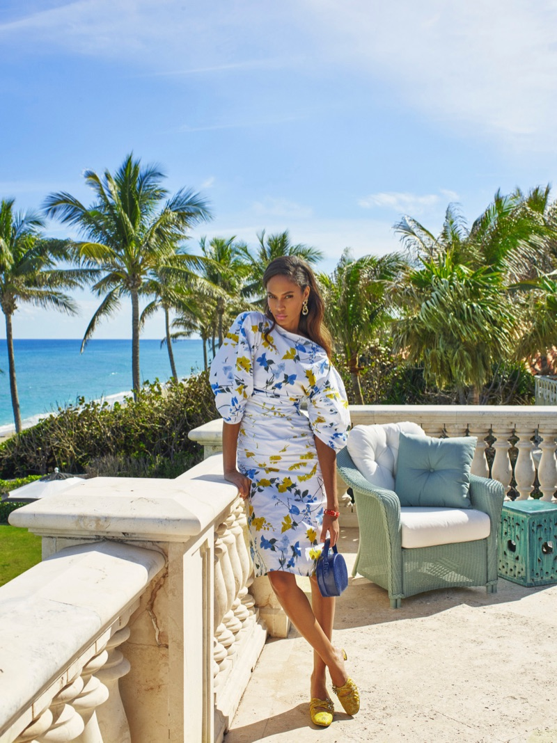Joan Smalls poses outdoors in printed dress