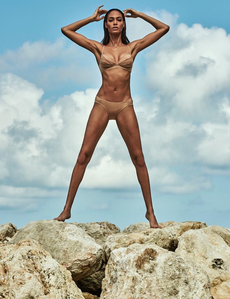 Model Joan Smalls poses in bandeau bikini top and bottoms from Smart & Sexy Swim Secret