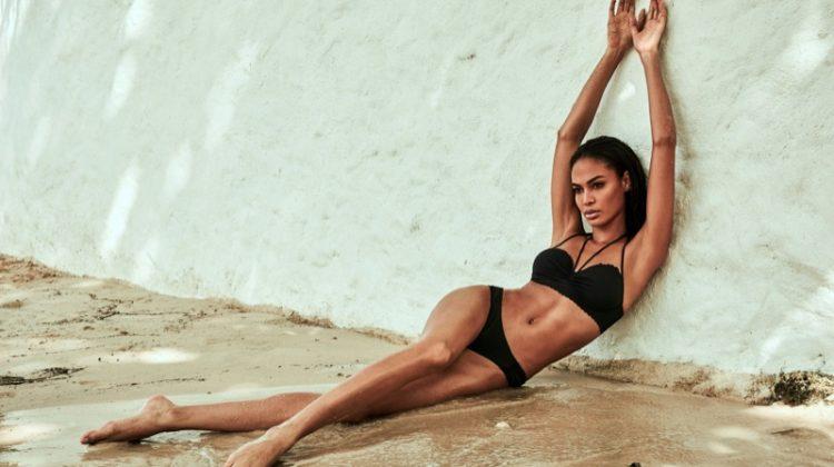 Joan Smalls poses in Swim Secret halter neck swim top