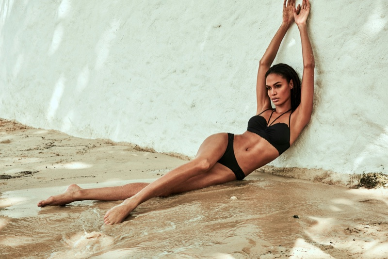 Joan Smalls poses in Swim Secret halter neck swim top