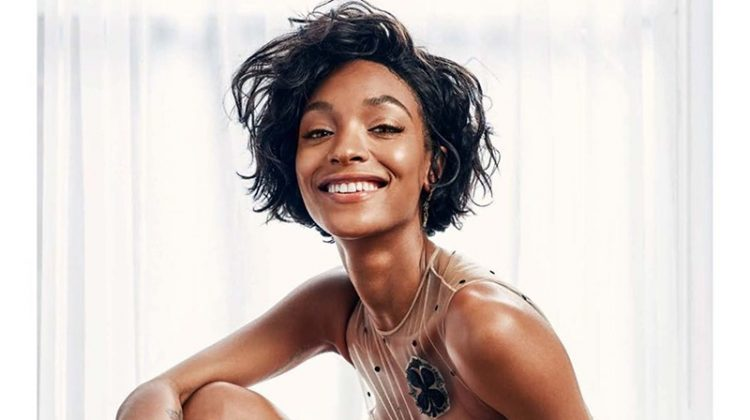 All smiles, Jourdan Dunn poses in Dior dress, briefs and boots