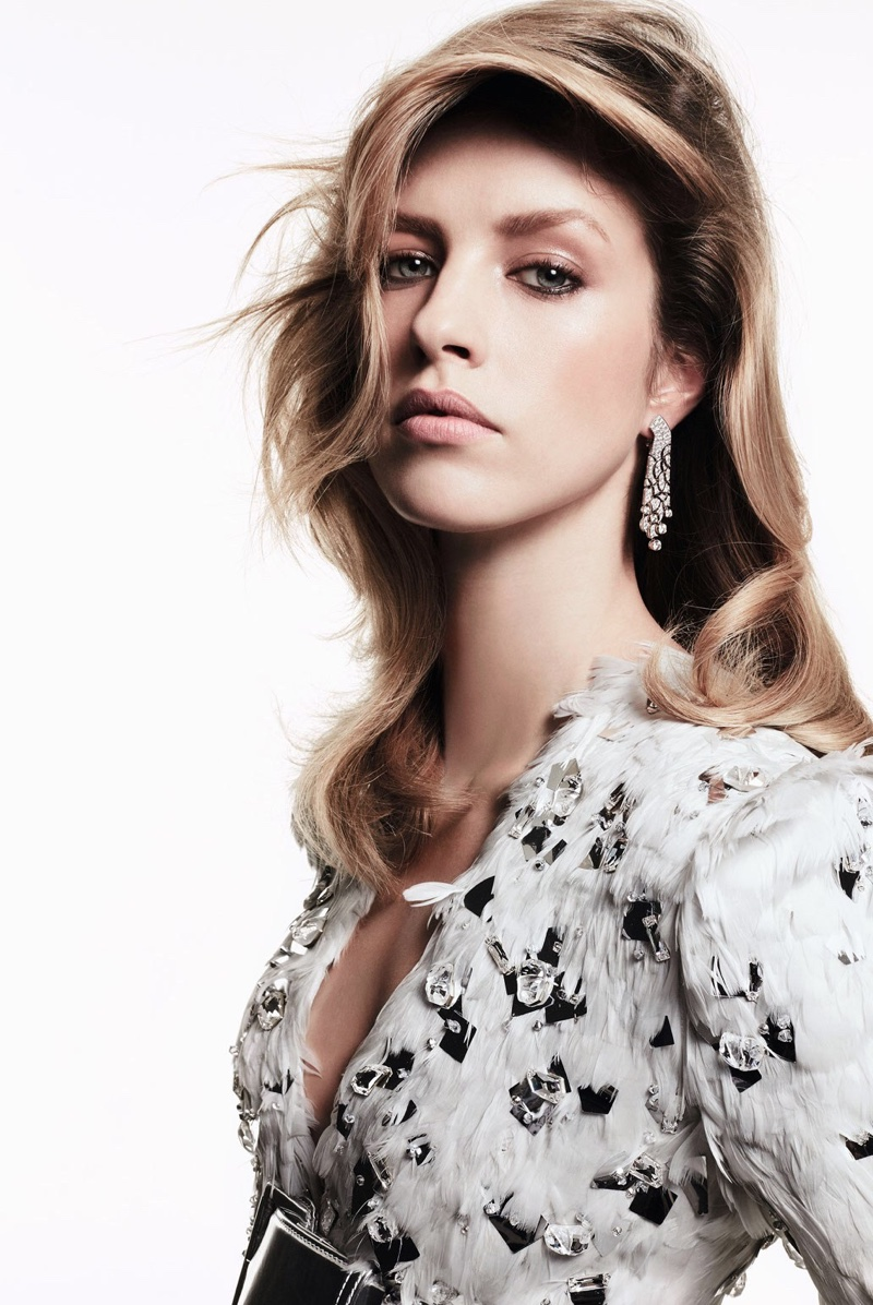 Model Julia Frauche wears Chanel Fine Jewelry earrings and feathered top