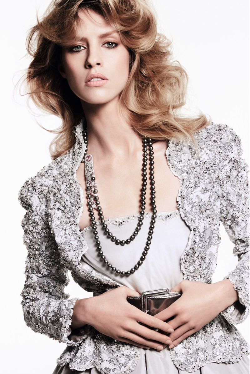 Julia Frauche poses in Chanel Haute Couture embroidered jacket and dress with Chanel Fine Jewelry