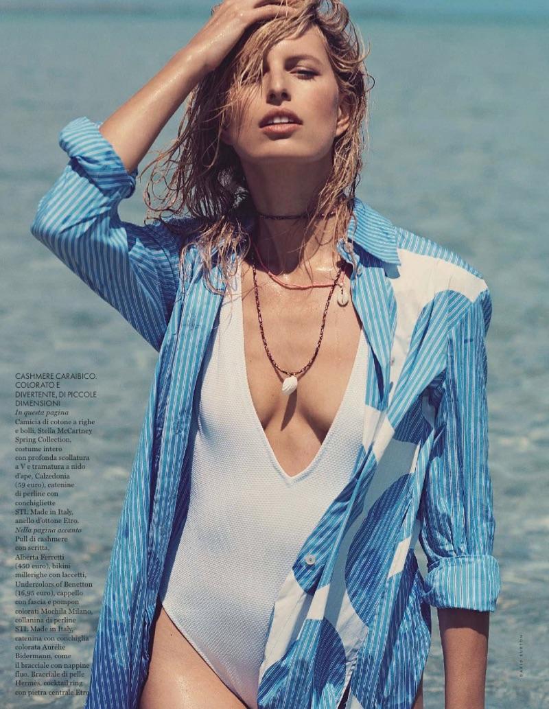 Hitting the beach, Karolina Kurkova poses in Stella McCartney shirt and Calzedonia swimsuit