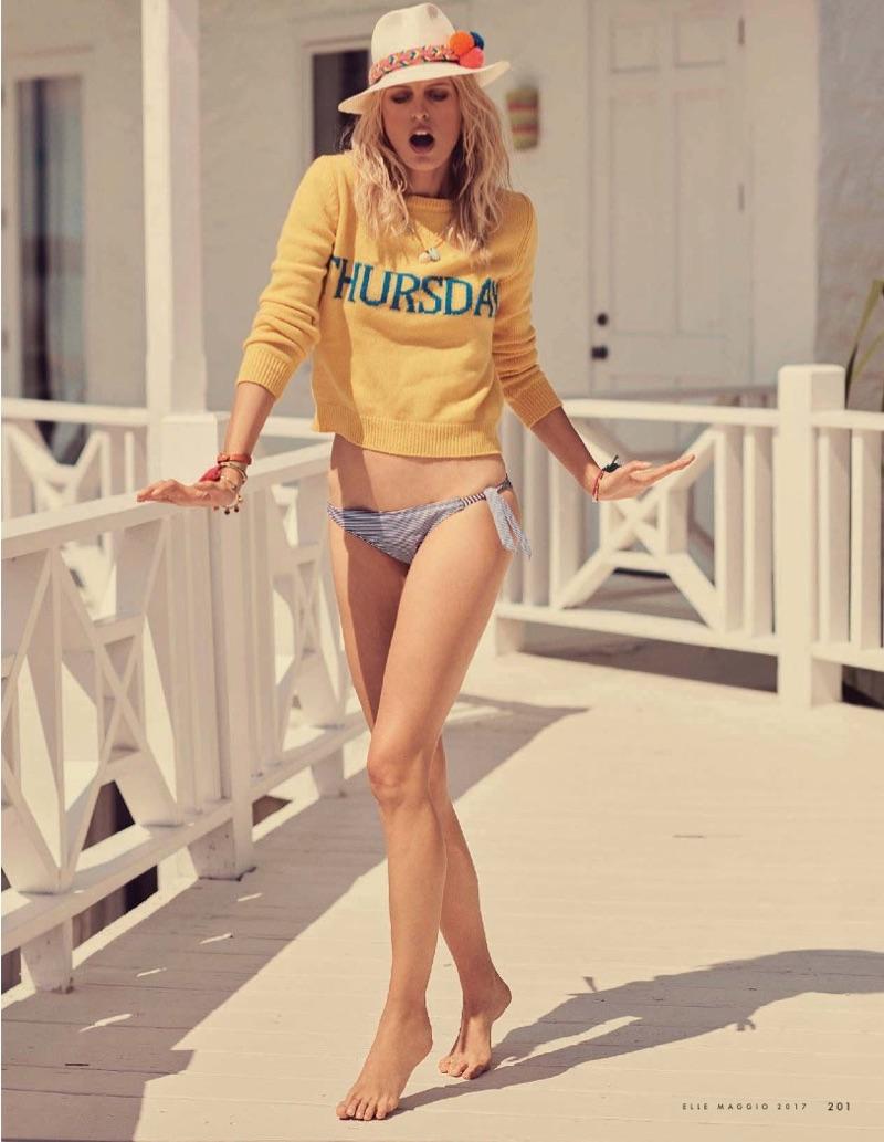 Karolina Kurkova models Alberta Ferretti knit sweater and Undercolors of Benetton bikini