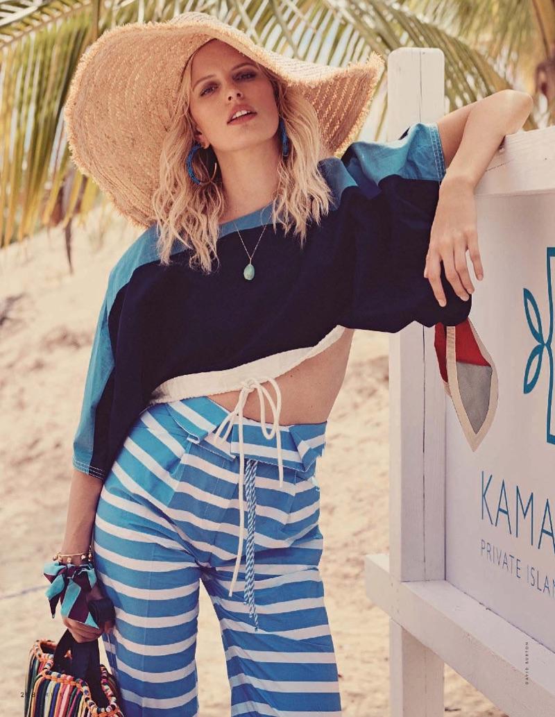 Karolina Kurkova models Chloe cropped blouse, Ermanno Scervino pants and Blumarine straw hat