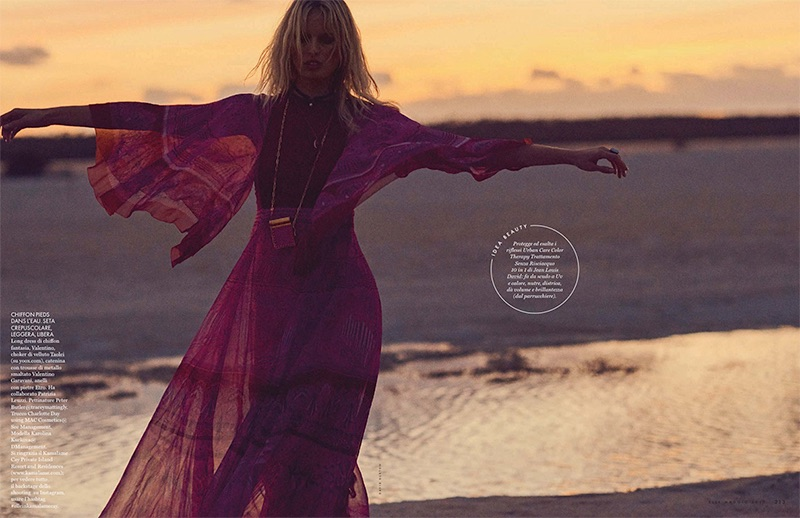 Looking bohemian chic, Karolina Kurkova poses in Valentino maxi dress and necklace