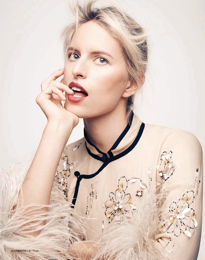 Getting her closeup, Karolina Kurkova models Prada top with feathered sleeves