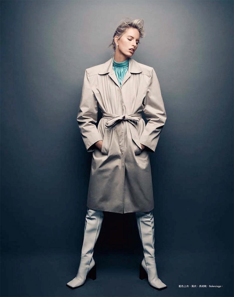 Layering up, Karolina Kurkova poses in Balenciaga trench coat, top and boots