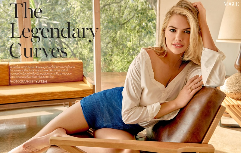 Lounging in style, Kate Upton wears white blouse and blue shorts