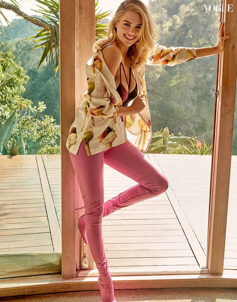 Kate Upton poses in Dolce & Gabbana shirt, Angelys Balek bralette and Balenciaga pants with boots