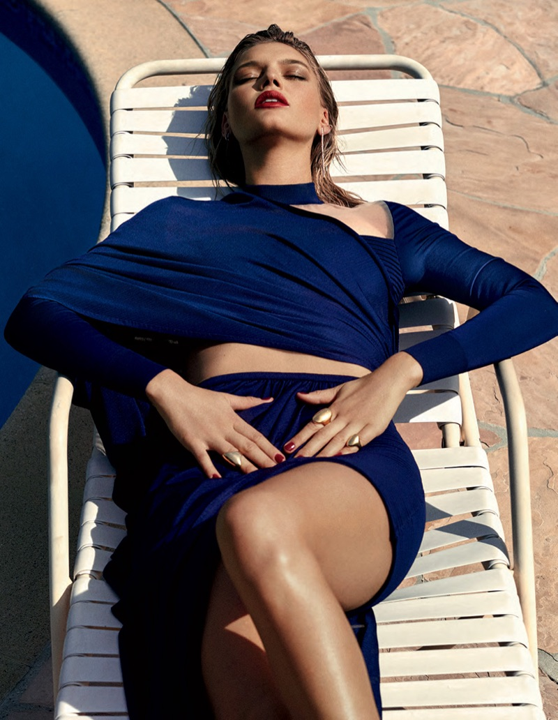 Lounging in the sun, Kelly Rohrbach poses in blue crop top and skirt