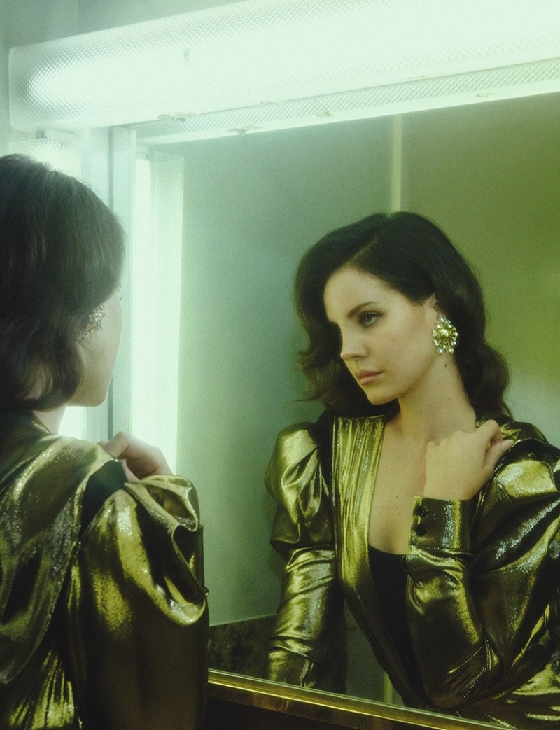 Lana Del Rey poses in Saint Laurent gold lamé dress and Louise Ferdinando earring