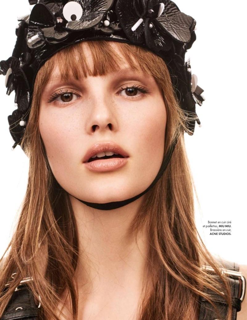 Getting her closeup, Lilly-Marie Liegau poses in Miu Miu swim cap and Acne Studios bra