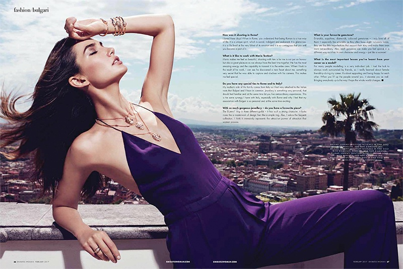 Wearing a jumpsuit, Lily Aldridge poses with Bulgari Seprenti Seduttori necklace. Rings and bracelets also from Bulgari.