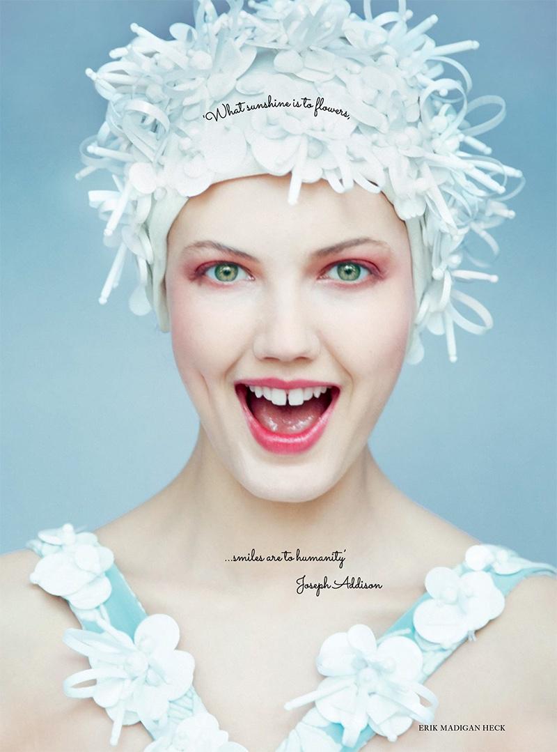 Getting her closeup, Lindsey Wixson models Miu Miu swim cap and swimsuit