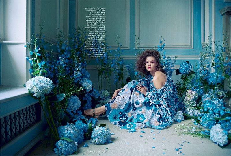 Surrounded by florals, Lindsey Wixson poses in Chloe silk and cotton mix top with matching skirt. Wedges by Miu Miu.