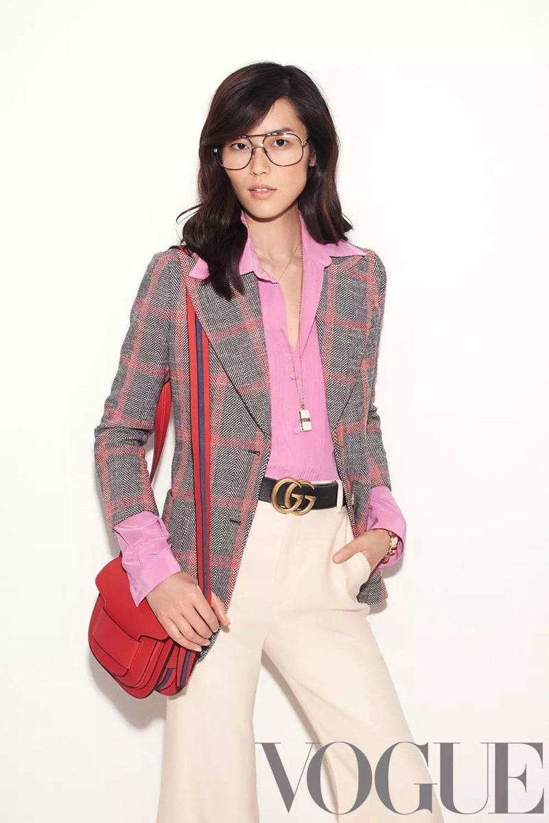 Model Liu Wen wears Gucci jacket, shirt, belt and pants