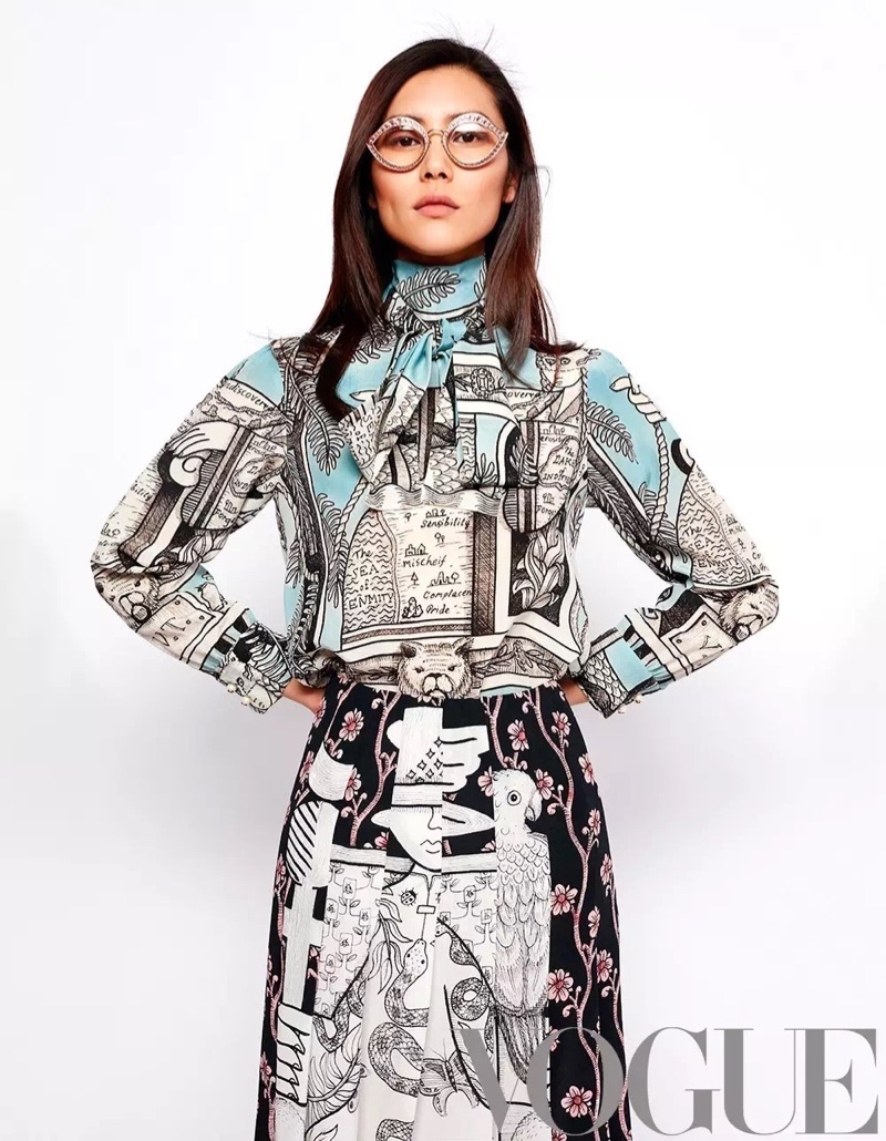 Liu Wen poses in Gucci printed blouse and skirt