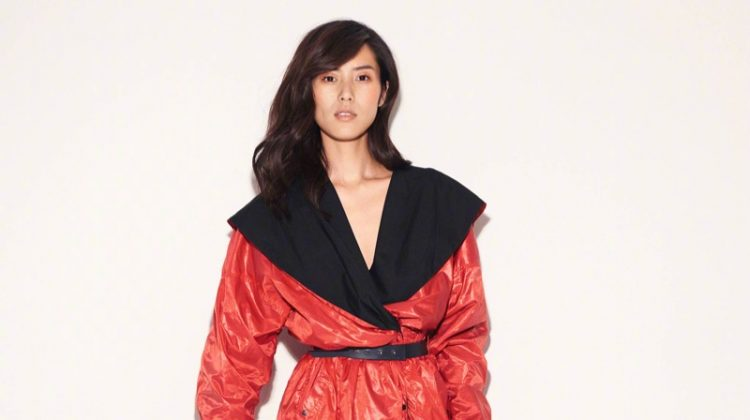 Channeling the 1980's Liu Wen gets wrapped up in red coat