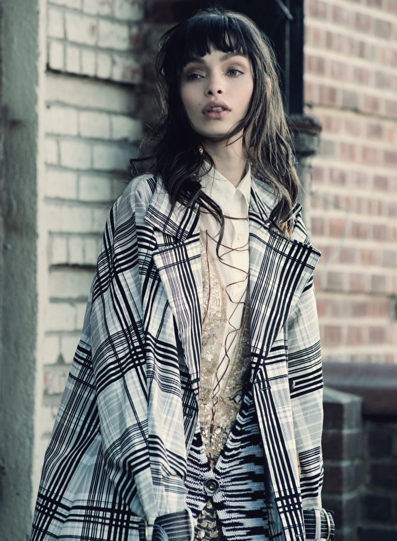 Luma Grothe layers up in plaid coat and knit cardigan