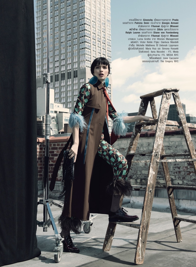 Luma Grothe poses in Givenchy sleeveless jacket with Prada top and pants