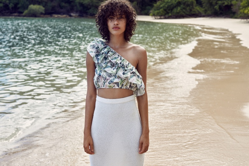 Alanna Arrington wears one-shoulder top and sheer skirt in Mango's Summer 2017 campaign
