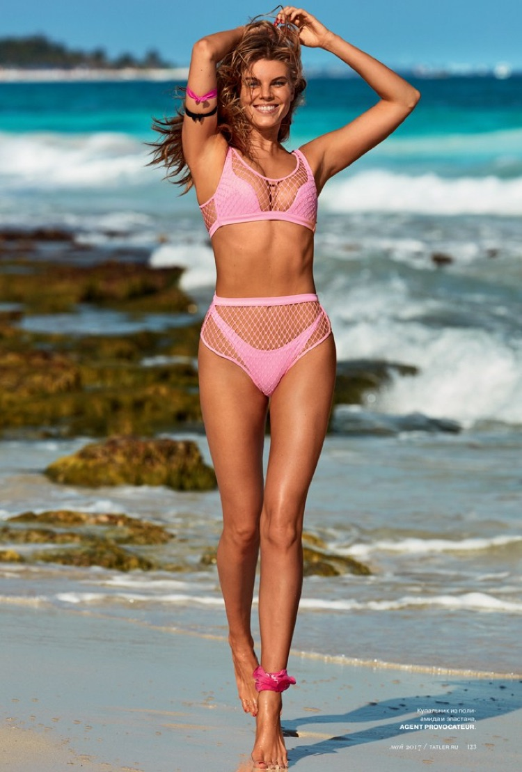 Looking pretty in pink, Maryna Linchuk poses in Agent Provocateur swimsuit