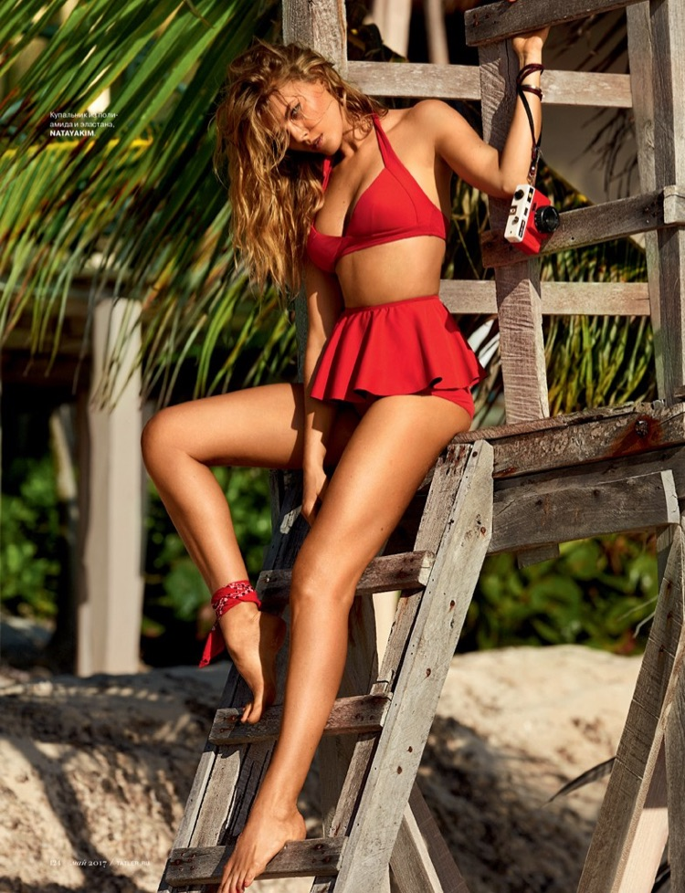 Looking red-hot, Maryna Linchuk models Natayakim bikini top and bottoms with pleated skirt