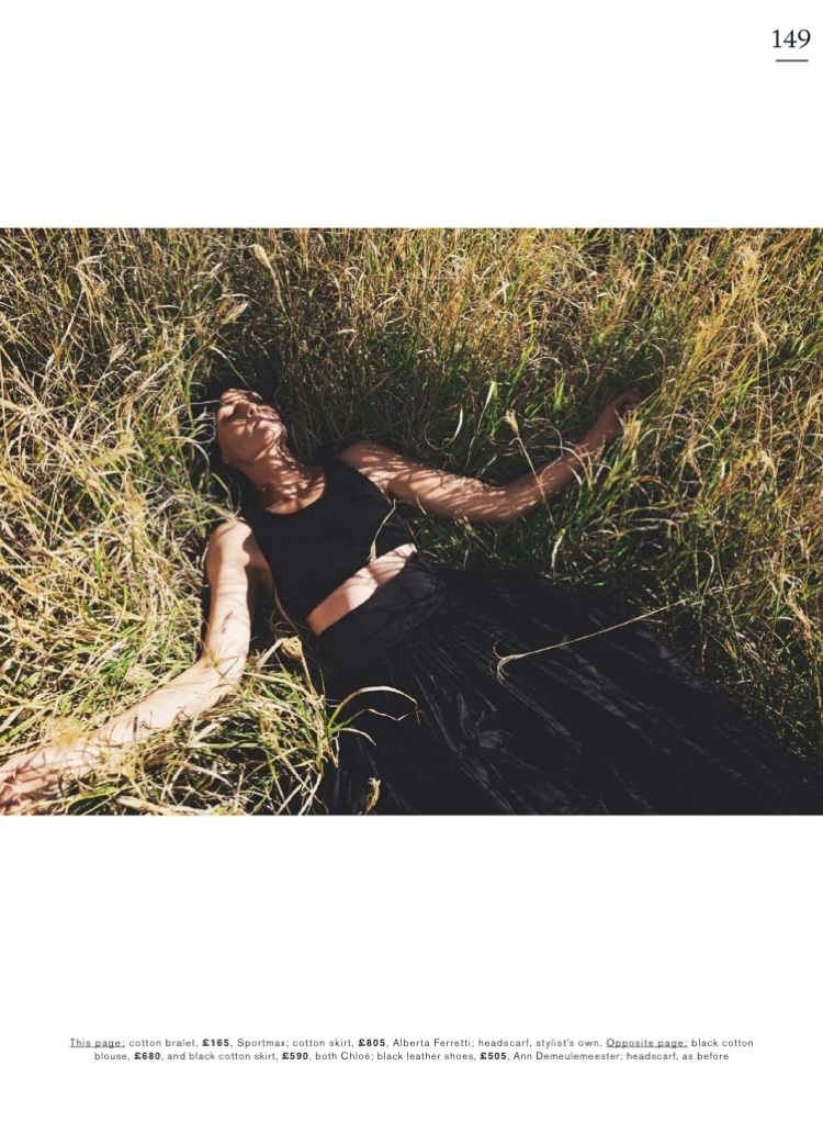 Surrounded by grass, Mini Anden poses in Sportmax cotton bralette and Alberta Ferretti cotton skirt
