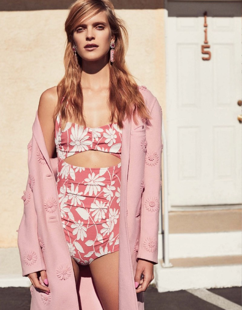 Looking pretty in pink, Mirte Maas models Valentino coat and Miu Miu swimsuit
