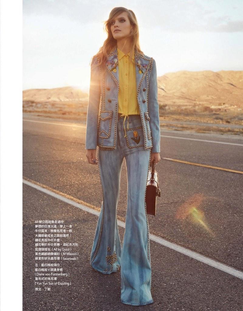 Mirte Maas models Gucci embellished pantsuit and bag