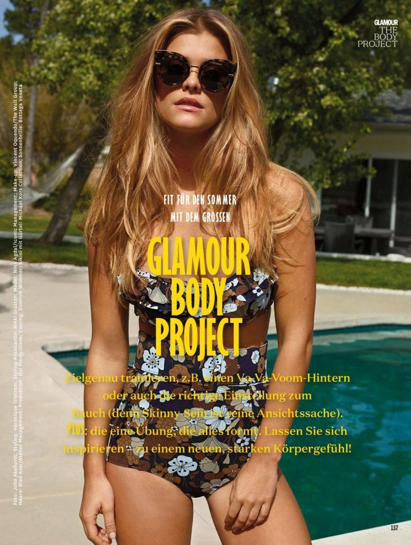 Model Nina Agdal wears Michael Kors Collection bikini top with matching briefs