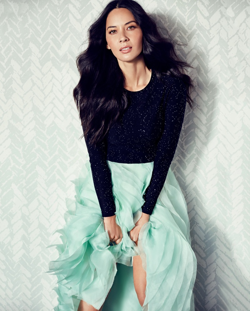 Photographed by Frankie Batista, Olivia Munn poses in Carolina Herrera top and skirt with Fernando Rodriguez ring