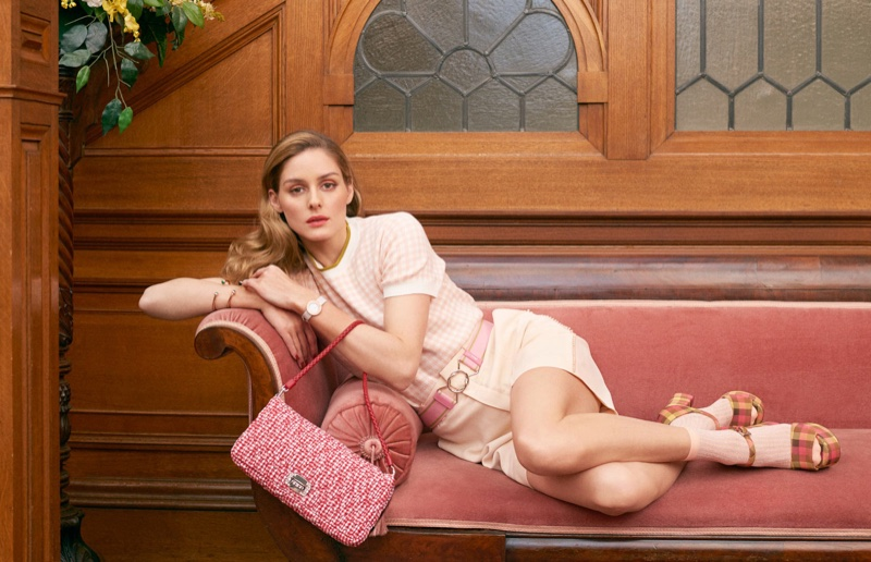 Looking pretty in pink, Olivia Palermo wears Miu Miu top and bag with Chloe shorts. Platform sandals by Prada.