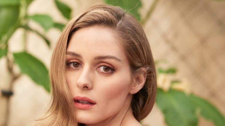 Wearing her hair in polished waves, Olivia Palermo models Michael Kors Collection bustier