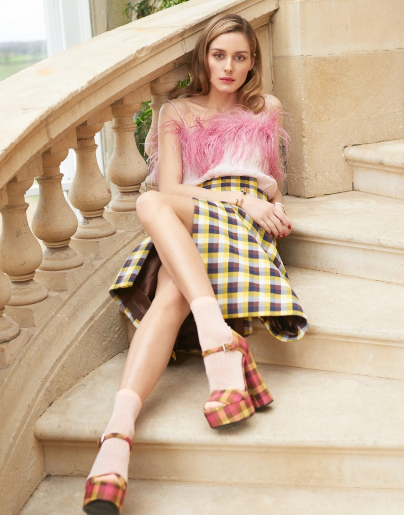 Embracing plaid, Olivia Palermo wears feathered top, skirt and platform sandals from Prada