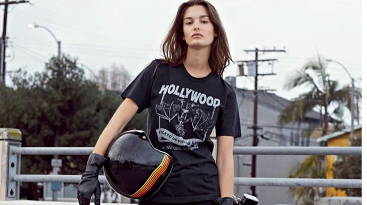 Posing next to a motorcycle, Ophelie Guillermand wears Local Authorities t-shirt, Seafarer jeans and Zadig & Voltaire boots