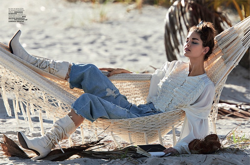 Lounging in a hammock, Ophelie Guillermand models Ermanno Scervino blouse, MM6 Maison Margiela jeans and Philosophy di Lorenzo Serafini boots