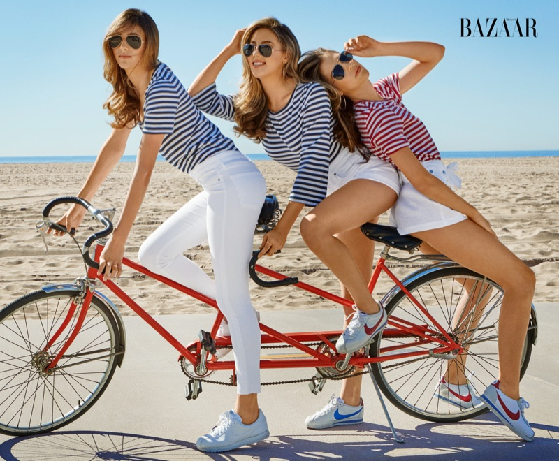 Sylvester Stallone's daughters, Sophia, Sistine and Scarlet, go bike riding in striped AG shirts