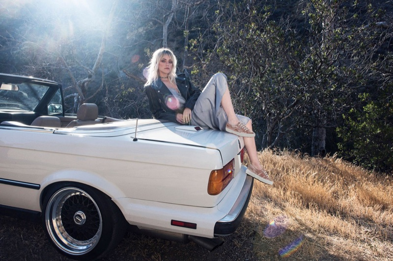 Posing outdoors, Pyper America Smith models Superga 2750 Cotmetu Sneakers in Rose Gold