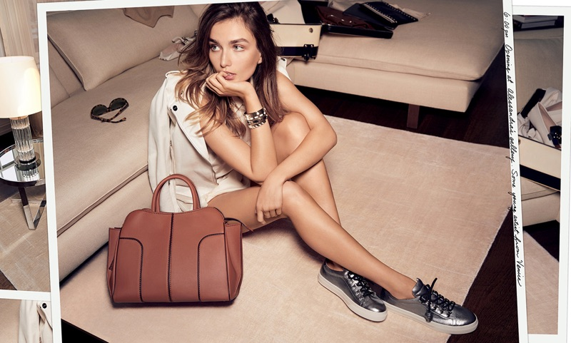 Andreea Diaconu models metallic sneakers and large tote bag in Tod's spring-summer 2017 campaign